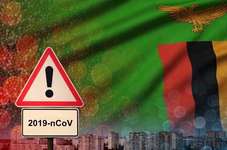 Zambia flag and virus 2019-nCoV alert sign.