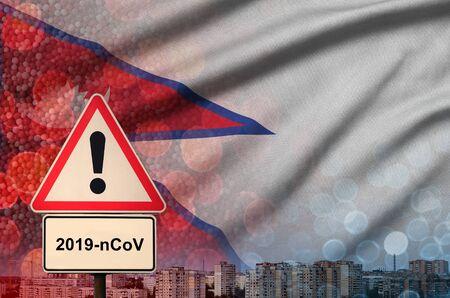 Nepal flag and virus 2019-nCoV alert sign.