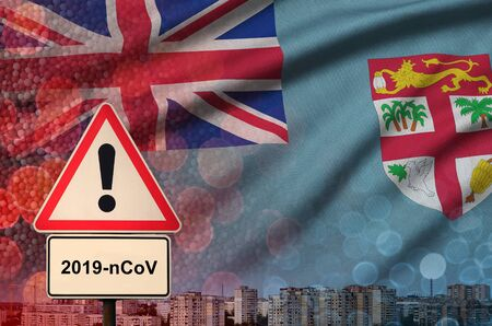 Fiji flag and virus 2019-nCoV alert sign. Concept of high probability of novel virus outbreak through traveling Chinese tourists