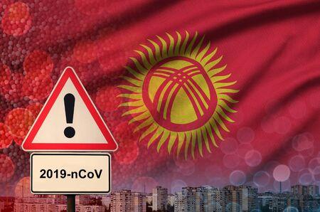 Kyrgyzstan flag and virus 2019-nCoV alert sign. Фото со стока