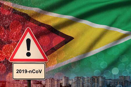 Guyana flag and virus 2019-nCoV alert sign.