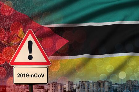 Mozambique flag and virus 2019-nCoV alert sign. Stock fotó