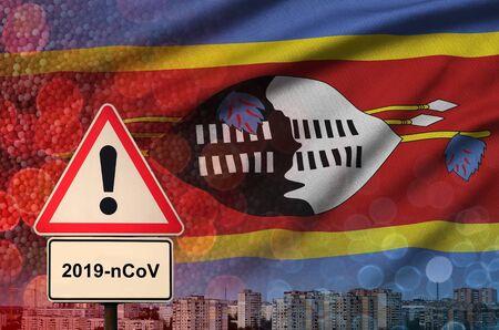 Swaziland flag and virus 2019-nCoV alert sign. Stock fotó