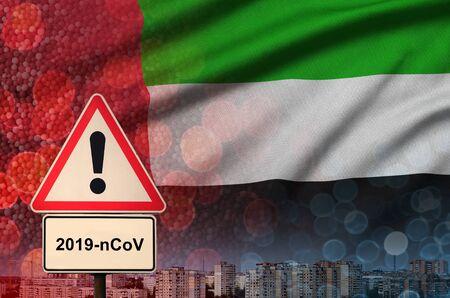 United Arab Emirates flag and virus 2019-nCoV alert sign. 版權商用圖片