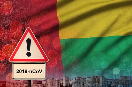 Guinea Bissau flag and virus 2019-nCoV alert sign. Stock Photo