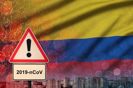 Colombia flag and virus 2019-nCoV alert sign. Фото со стока