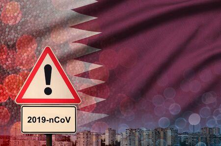 Qatar flag and virus 2019-nCoV alert sign. Фото со стока