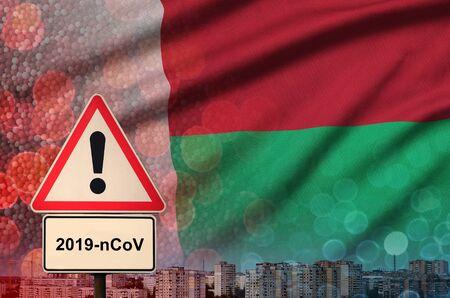 Madagascar flag and virus 2019-nCoV alert sign.
