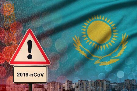 Kazakhstan flag and virus 2019-nCoV alert sign.