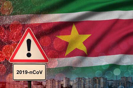 Suriname flag and virus 2019-nCoV alert sign. Фото со стока