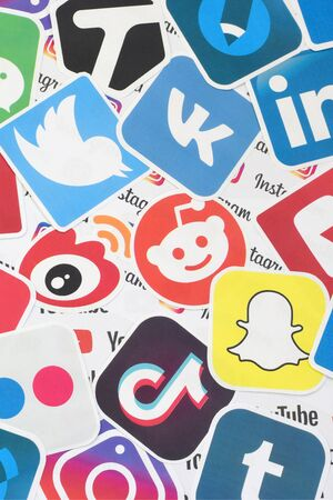 KHARKOV, UKRAINE - FEBRUARY 17, 2020: Many paper logos of popular social networks and internet resources. Colorful banner