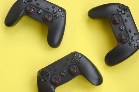 KHARKOV, UKRAINE - JANUARY 19, 2020: Gamesir g3s video game controllers on yellow background Editorial