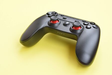 KHARKOV, UKRAINE - JANUARY 19, 2020: Gamesir g3s video game controller on yellow background Editorial