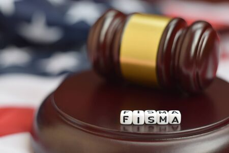 Justice mallet and FISMA acronym close up. Federal information security management act 版權商用圖片