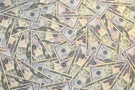 Many US fifty dollar bills on flat background surface close up. Flat lay top view. Abstract success or business concept Stock Photo