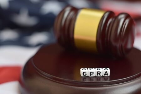 Justice mallet and GPRA acronym close up. Government performance and results act