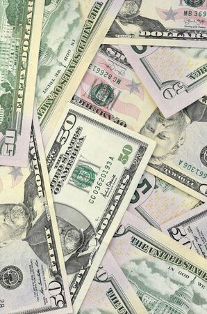 Many US fifty dollar bills on flat background surface close up. Flat lay top view. Abstract success or business concept