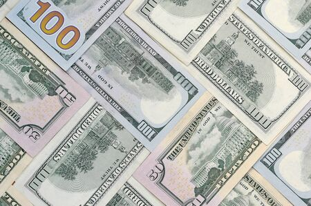 Many one hundred and fifty dollar bills on flat background surface close up. Flat lay top view. Abstract success or business concept