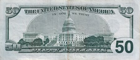 US Capitol on 50 dollars banknote back side closeup macro fragment. United states fifty dollars money bill close up