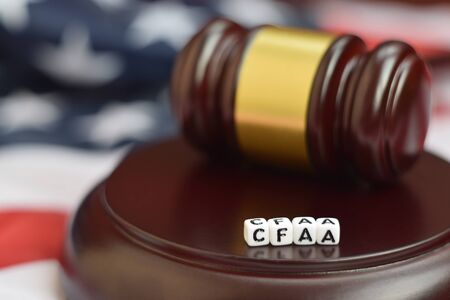 Justice mallet and CFAA acronym close up. Computer fraud and abuse act 版權商用圖片