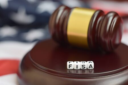 Justice mallet and FISA acronym close up. Foreign intelligence surveillance act