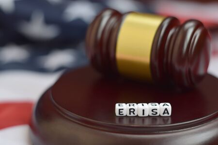 Justice mallet and ERISA acronym close up. Employee retirement income security act