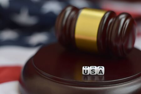 Justice mallet and USA acronym close up. United States of America