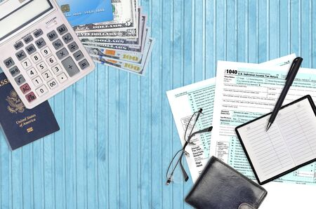 IRS form 1040 Individual income tax return lies on flat lay office table and ready to fill. U.S. Internal revenue services paperwork concept. Time to pay taxes in United States. Top view Standard-Bild