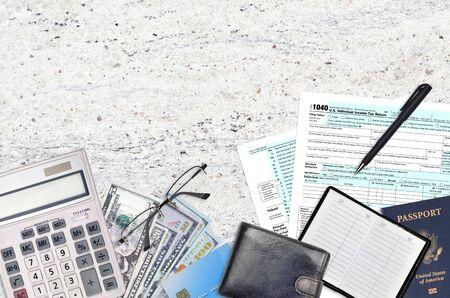 IRS form 1040 Individual income tax return lies on flat lay office table and ready to fill. U.S. Internal revenue services paperwork concept. Time to pay taxes in United States. Top view Stock Photo