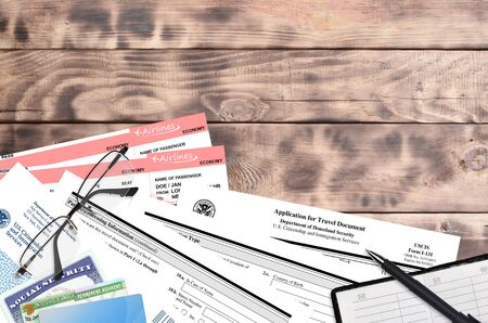 USCIS form I-131 Application for travel document lies on flat lay office table and ready to fill. U.S. Citizenship and Immigration services paperwork concept. Top view Reklamní fotografie