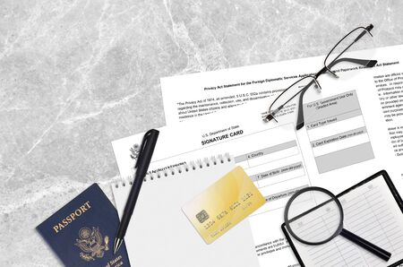 Department of State form DS4139 Signature card lies on table and ready to fill. Paperwork during operations with US Passport concept. Flat lay top view Foto de archivo