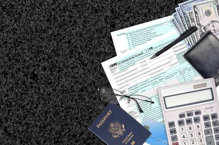 IRS form 1040 Individual income tax return lies on flat lay office table and ready to fill. U.S. Internal revenue services paperwork concept. Time to pay taxes in United States. Top view Banco de Imagens - 149069081