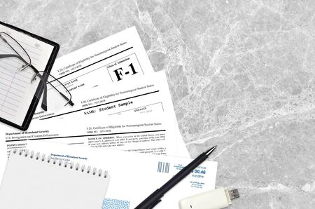 USCIS form I-20 Certificate of eligibility for nonimmigrant student status lies on flat lay office table and ready to fill. U.S. Citizenship and Immigration services paperwork concept. Top view