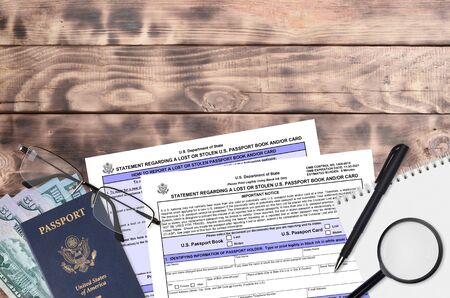 Department of State form DS64 Statement regarding a lost or stolen us passport book and or card lies on table and ready to fill. Paperwork during operations with US Passport concept Foto de archivo