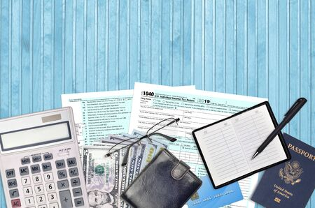 IRS form 1040 Individual income tax return lies on flat lay office table and ready to fill. U.S. Internal revenue services paperwork concept. Time to pay taxes in United States. Top view