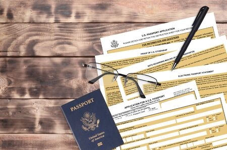 Department of State form DS11 Application for a U.S. Passport lies on table and ready to fill. Paperwork during operations with US Passport concept. Flat lay top view Фото со стока