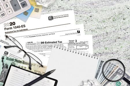 IRS form 1040-es Estimated tax for Individuals lies on flat lay office table and ready to fill. U.S. Internal revenue services paperwork concept. Time to pay taxes in United States. Top view