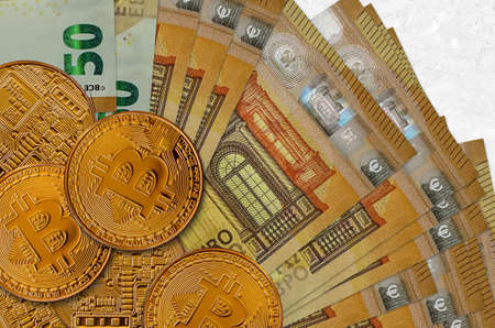 50 euro bills and golden bitcoins. Cryptocurrency investment concept. Crypto mining or trading transactions