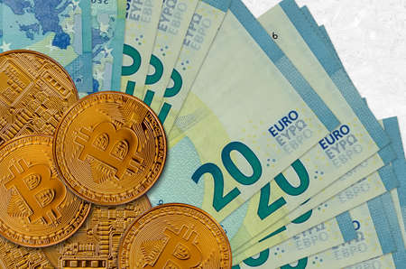 20 euro bills and golden bitcoins. Cryptocurrency investment concept. Crypto mining or trading transactions