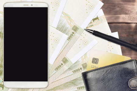 1 Chinese yuan bills and smartphone with purse and credit card. E-payments or e-commerce concept. Online shopping and business with portable devices usage