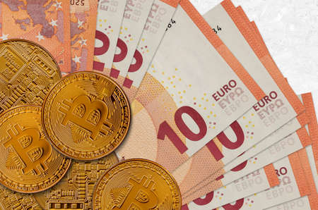 10 euro bills and golden bitcoins. Cryptocurrency investment concept. Crypto mining or trading transactions