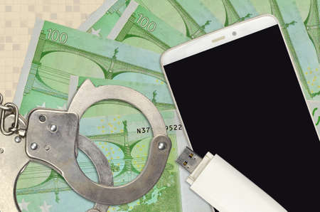 100 Euro bills and smartphone with police handcuffs. Concept of hackers phishing attacks, illegal scam or online spyware soft distribution