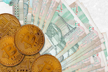 20 Thai Baht bills and golden bitcoins. Cryptocurrency investment concept. Crypto mining or trading transactions