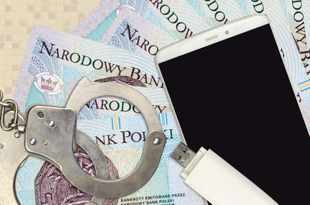 10 Polish zloty bills and smartphone with police handcuffs. Concept of hackers phishing attacks, illegal scam or online spyware soft distribution Stock fotó