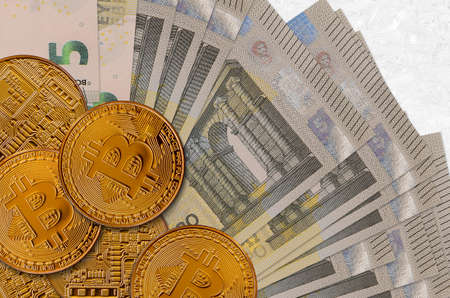 5 euro bills and golden bitcoins. Cryptocurrency investment concept. Crypto mining or trading transactions