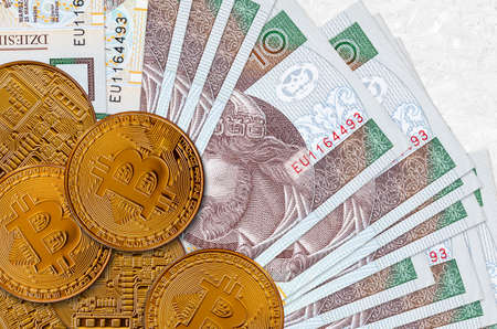 10 Polish zloty bills and golden bitcoins. Cryptocurrency investment concept. Crypto mining or trading transactions Stock fotó
