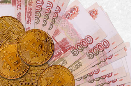 5000 russian rubles bills and golden bitcoins. Cryptocurrency investment concept. Crypto mining or trading transactions