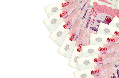 500 Cambodian riels bills lies isolated on white background with copy space. Rich life conceptual background. Big amount of national currency wealth