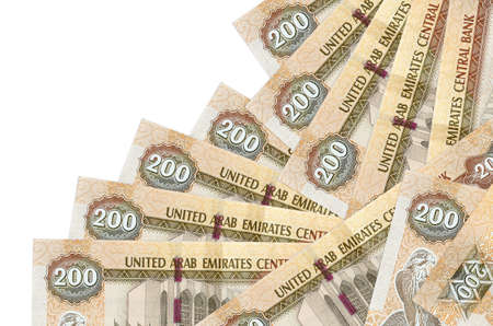 200 UAE dirhams bills lies in different order isolated on white. Local banking or money making concept. Business background banner