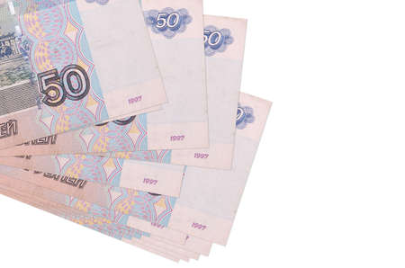 50 russian rubles bills lies in small bunch or pack isolated on white. Mockup with copy space. Business and currency exchange concept